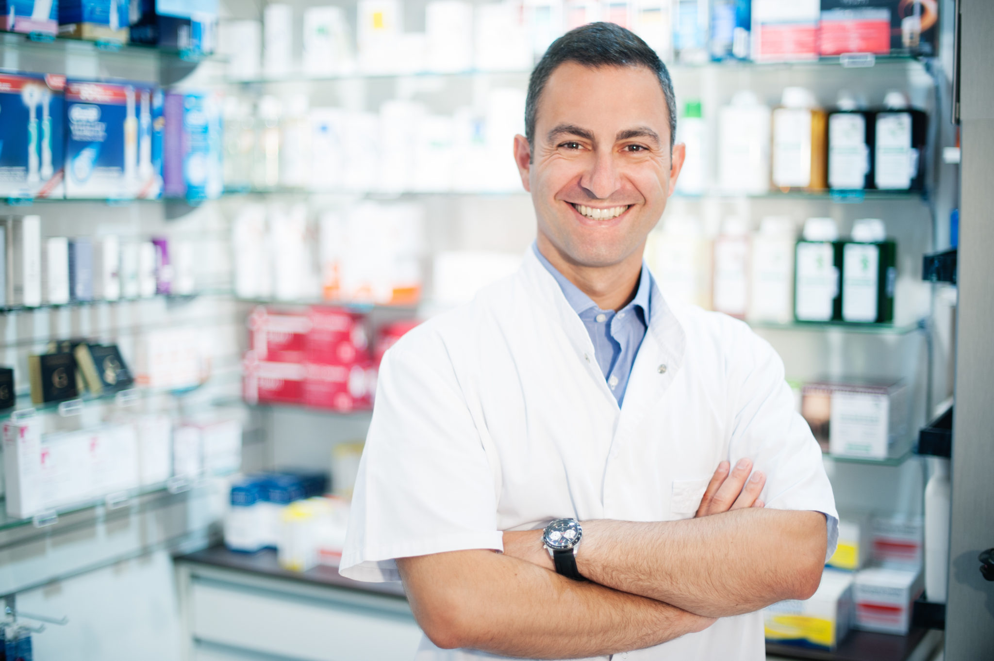 cheerful smiling pharmacist chemist man standing in pharmacy Guardian Healthcare Main Office Located in Brockway, PA Pennsylvania