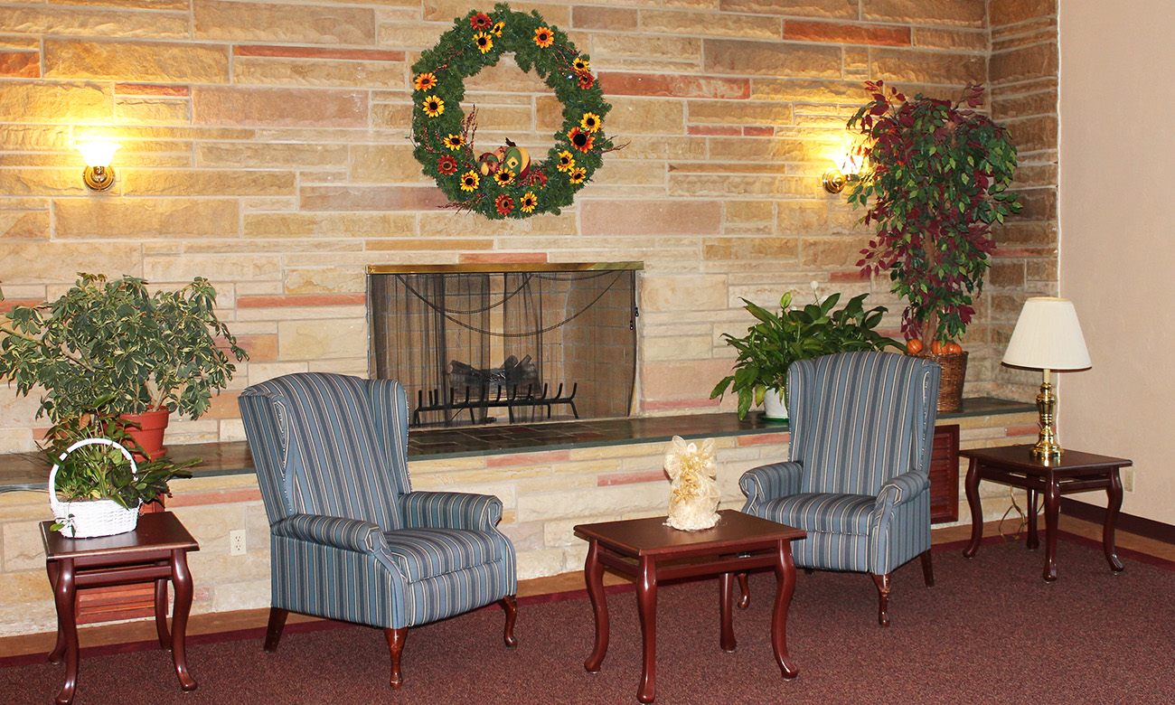 Common Room with Fireplace and Wreath
